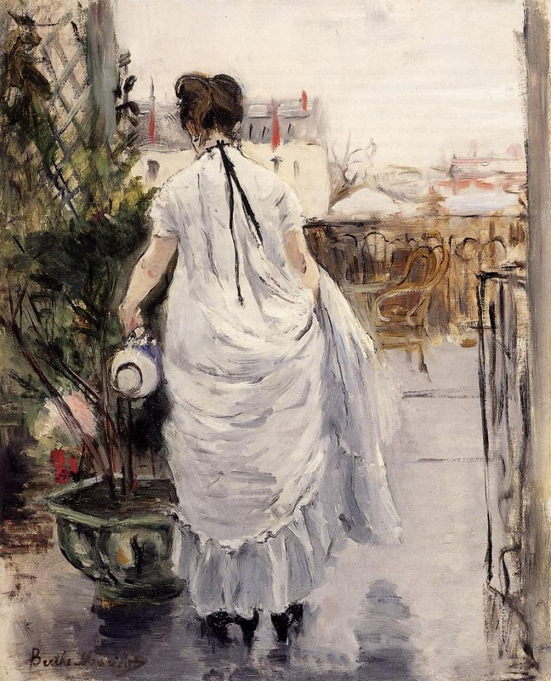 young-woman-watering-a-shrub